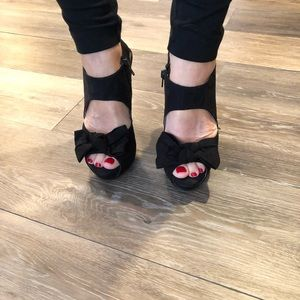 Black suede heels with bow detail